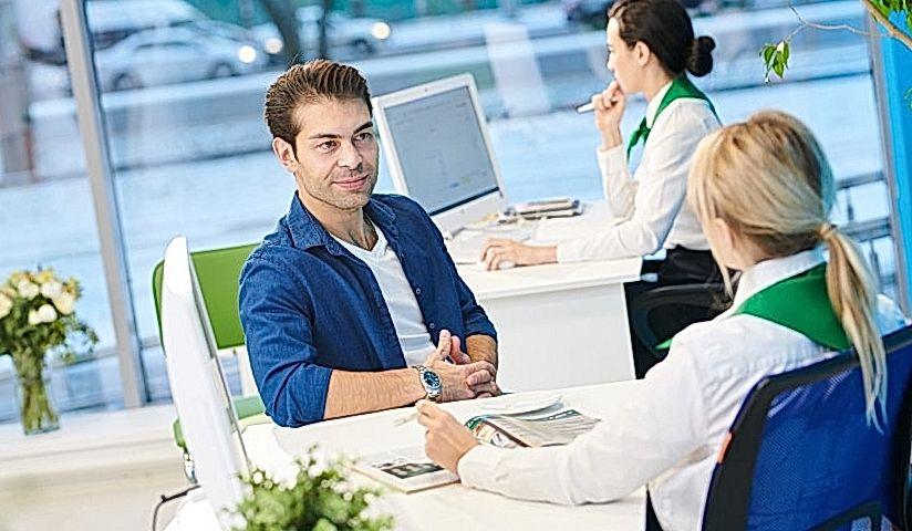 man speaking to bank manager